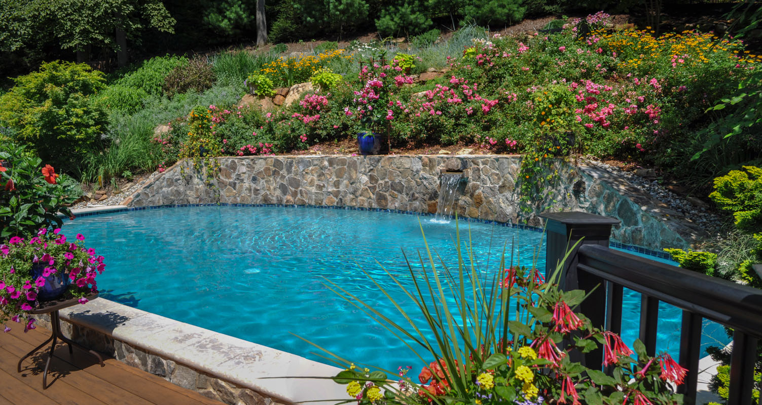 before and after landscape pictures, after, steep slope with swimming pool