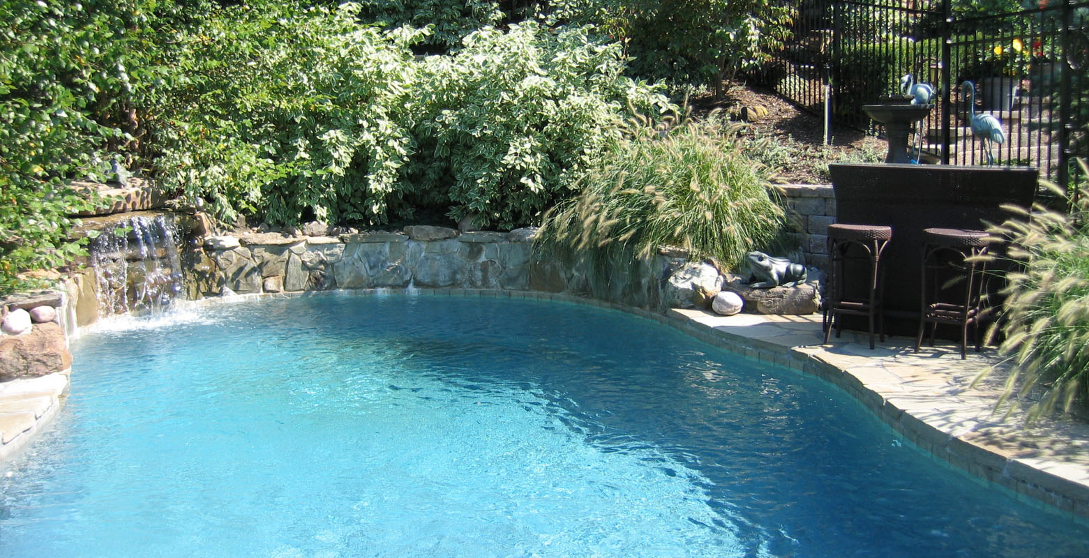 before and after landscape pictures, after, nj swimming pool design, pool waterfall