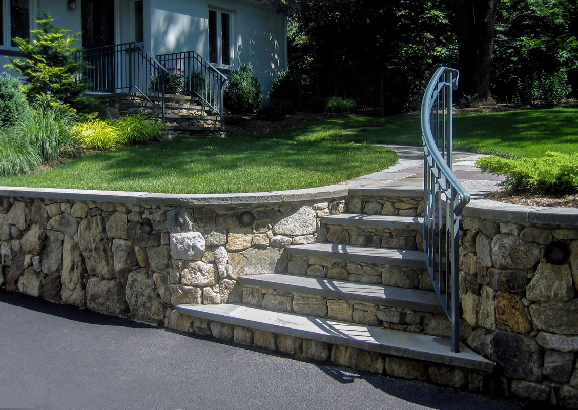 before and after landscape pictures, after, natural stone retaining wall and steps