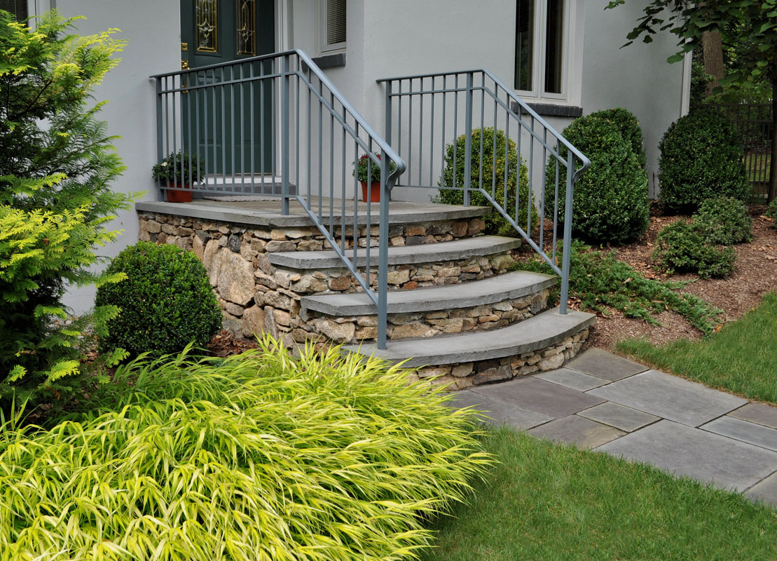 before and after landscape pictures. after, natural stone landing and steps