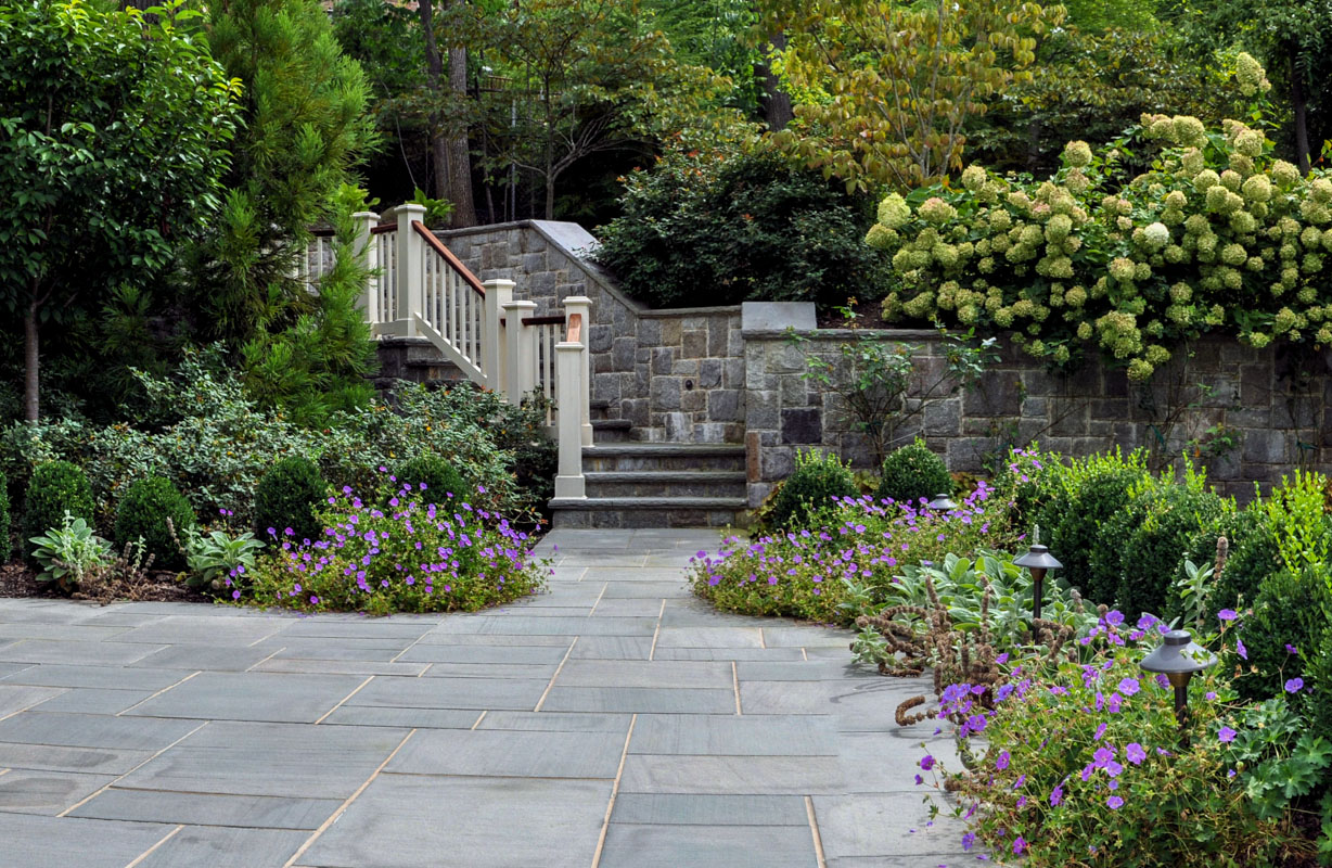 patio, outdoor steps, and retaining wall