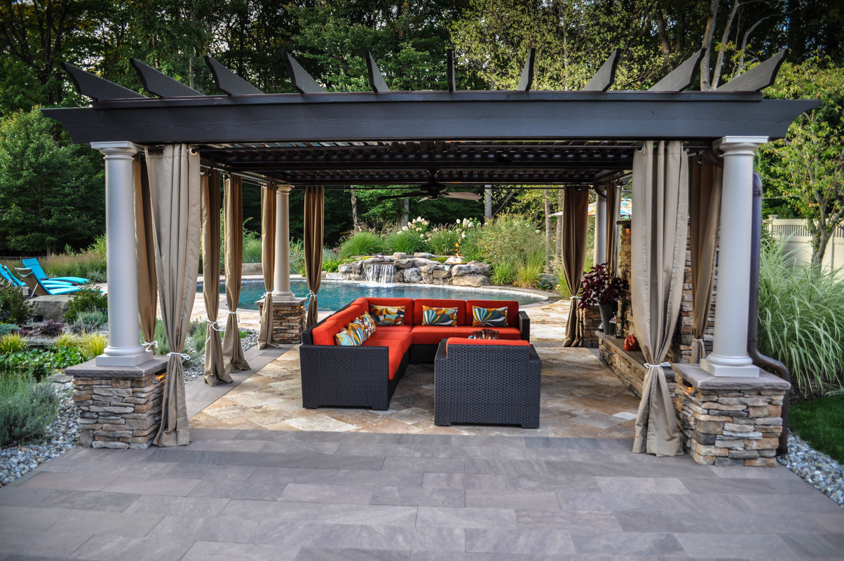 backyard landscape with pergola, pool, spa, and pool patio