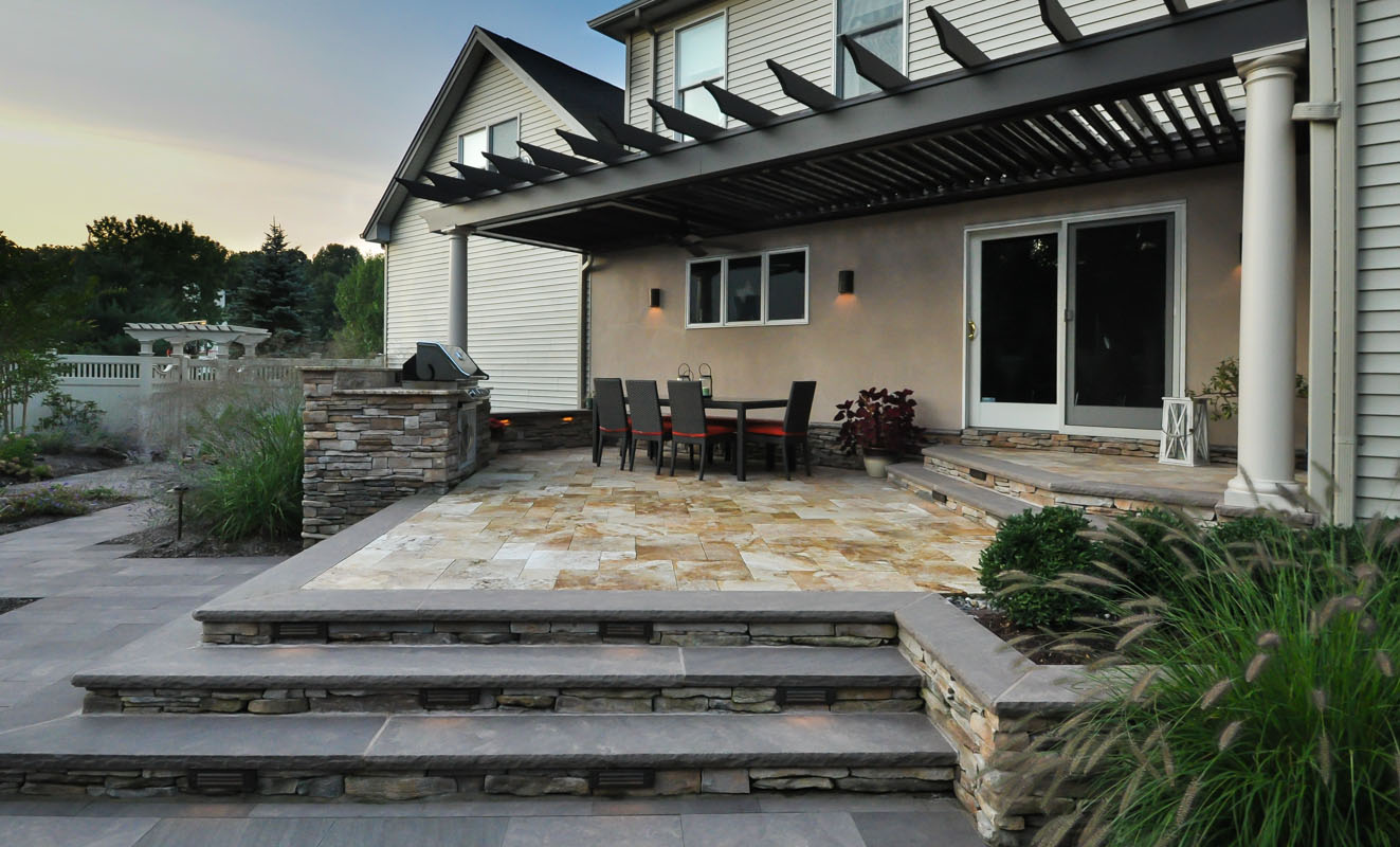 raised patio with outdoor dining area