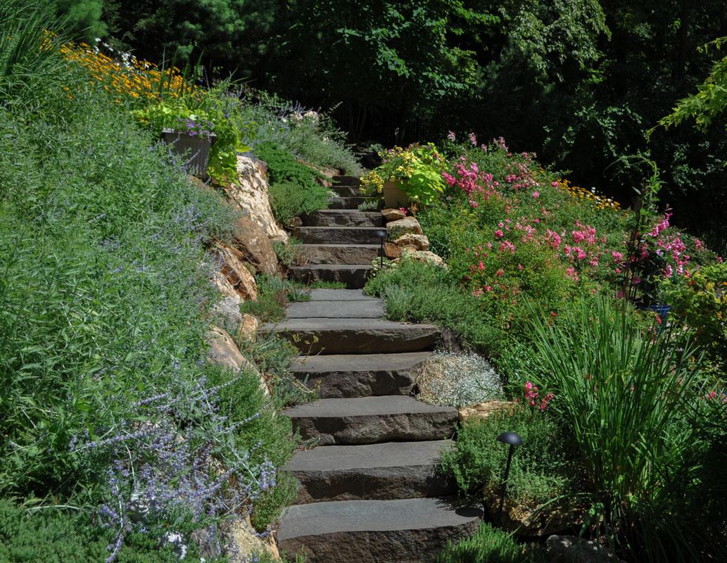 stone slab steps up sloped backyard