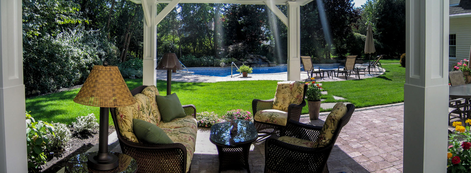 landscape design with patio, pavilion, and swimming pool