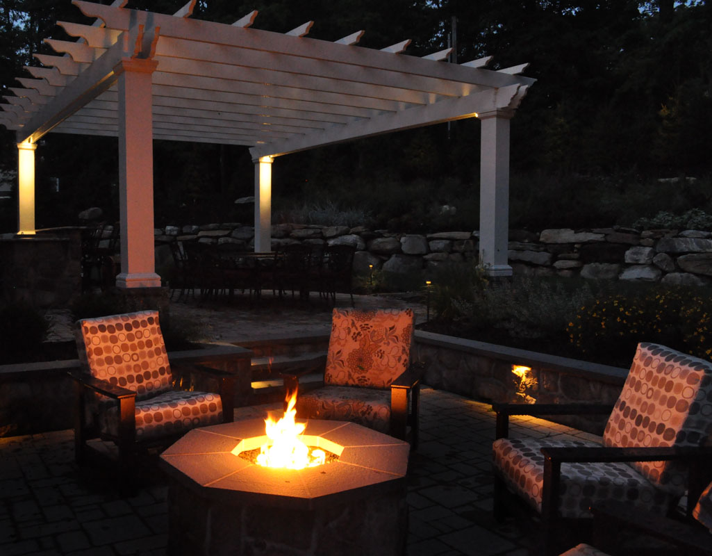 gas fire pit at night with fire burning