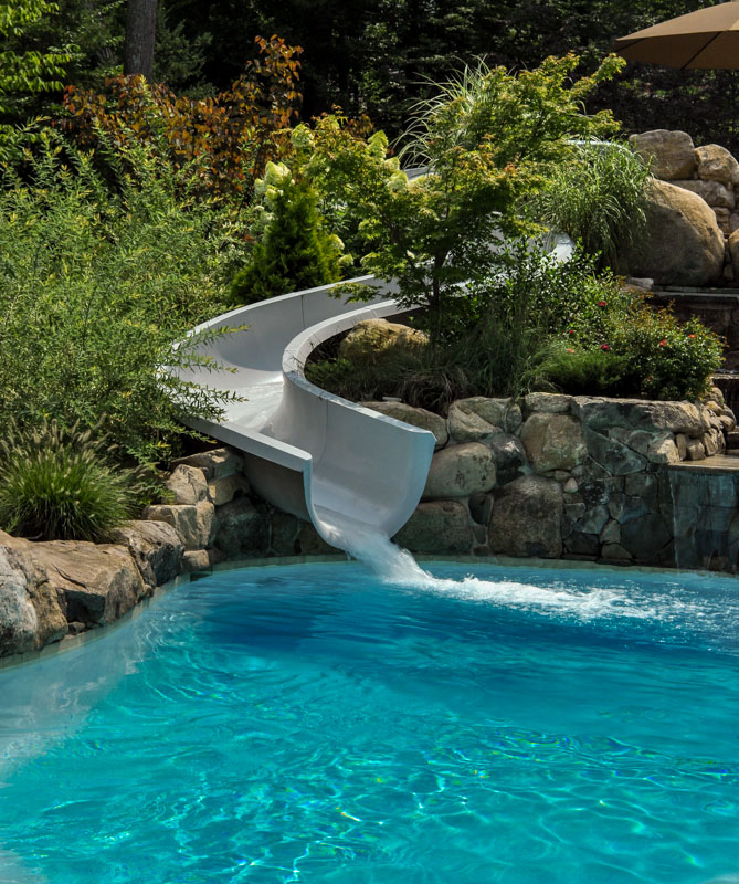 custom waterslide enters swimming pool
