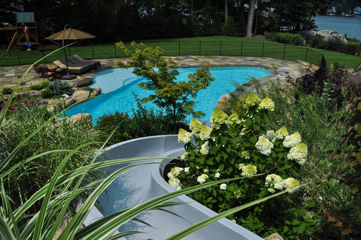 view from top of waterslide into custom swimming pool