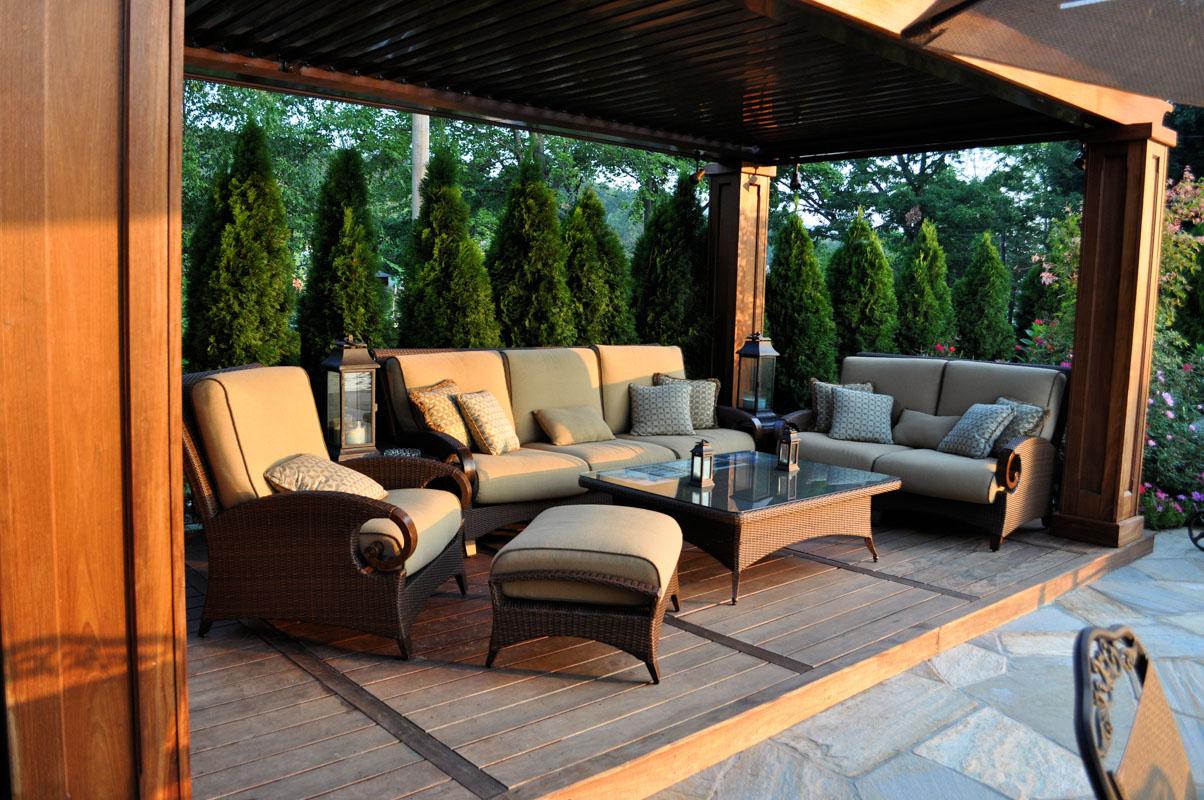patio furniture in pergola with arborvitae for privacy - nj