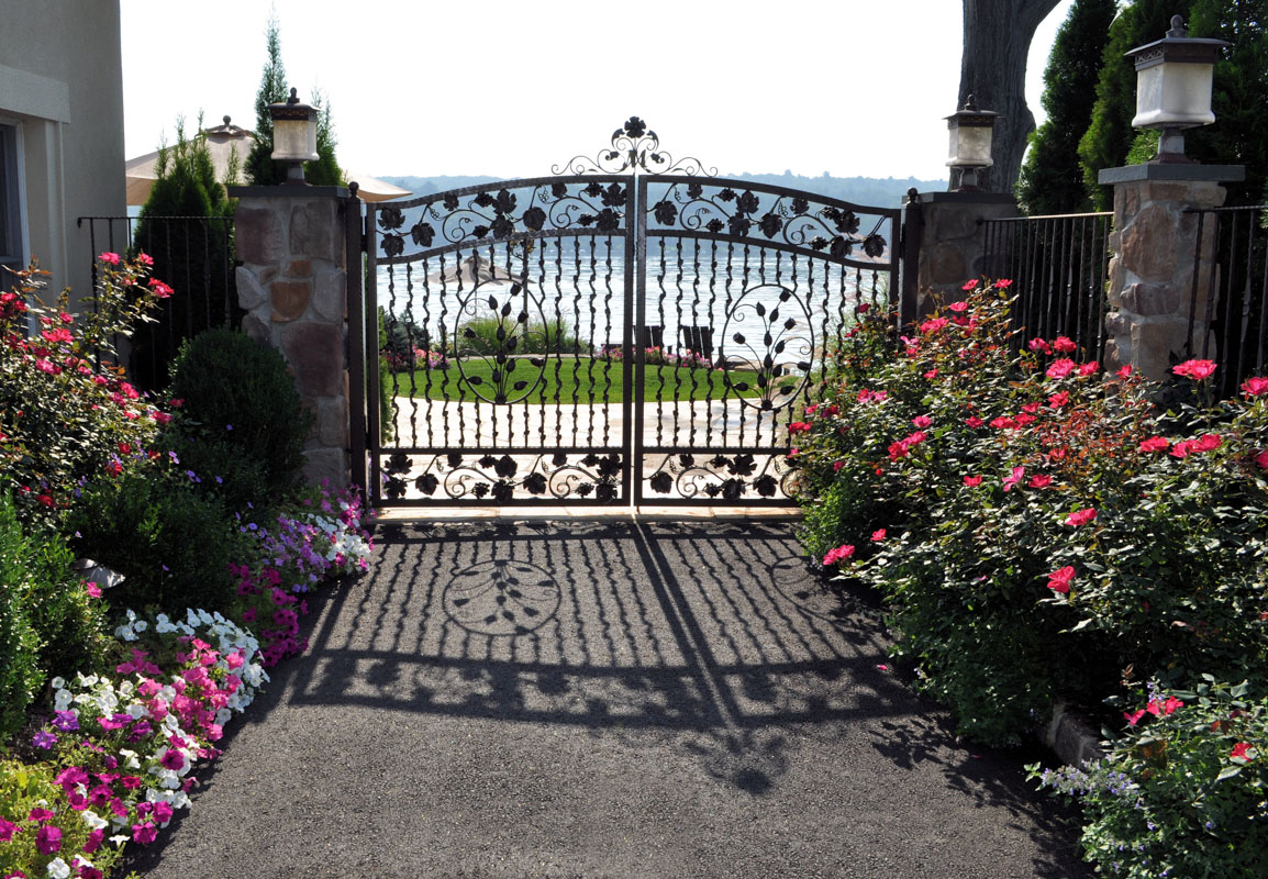 petunias and knock out roses frame entrance gate - nj