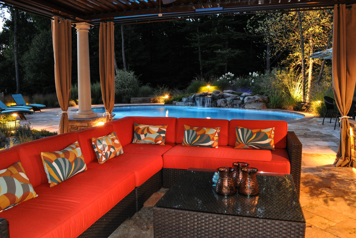 pool landscaping illuminated with landscape lighting