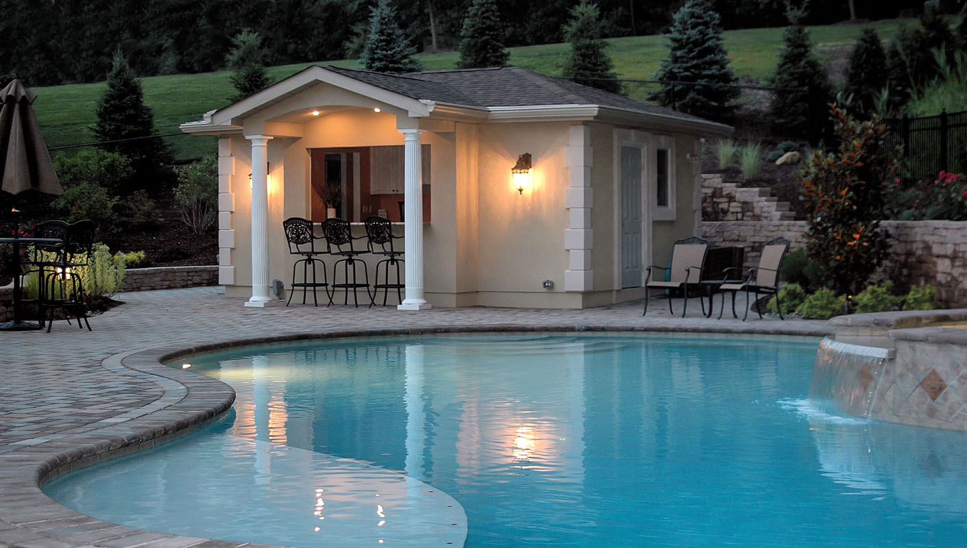 pool house with outdoor lighting