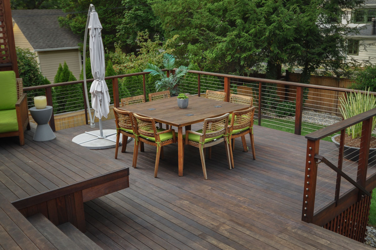 deck dining table with eight wood chairs around it - north jersey