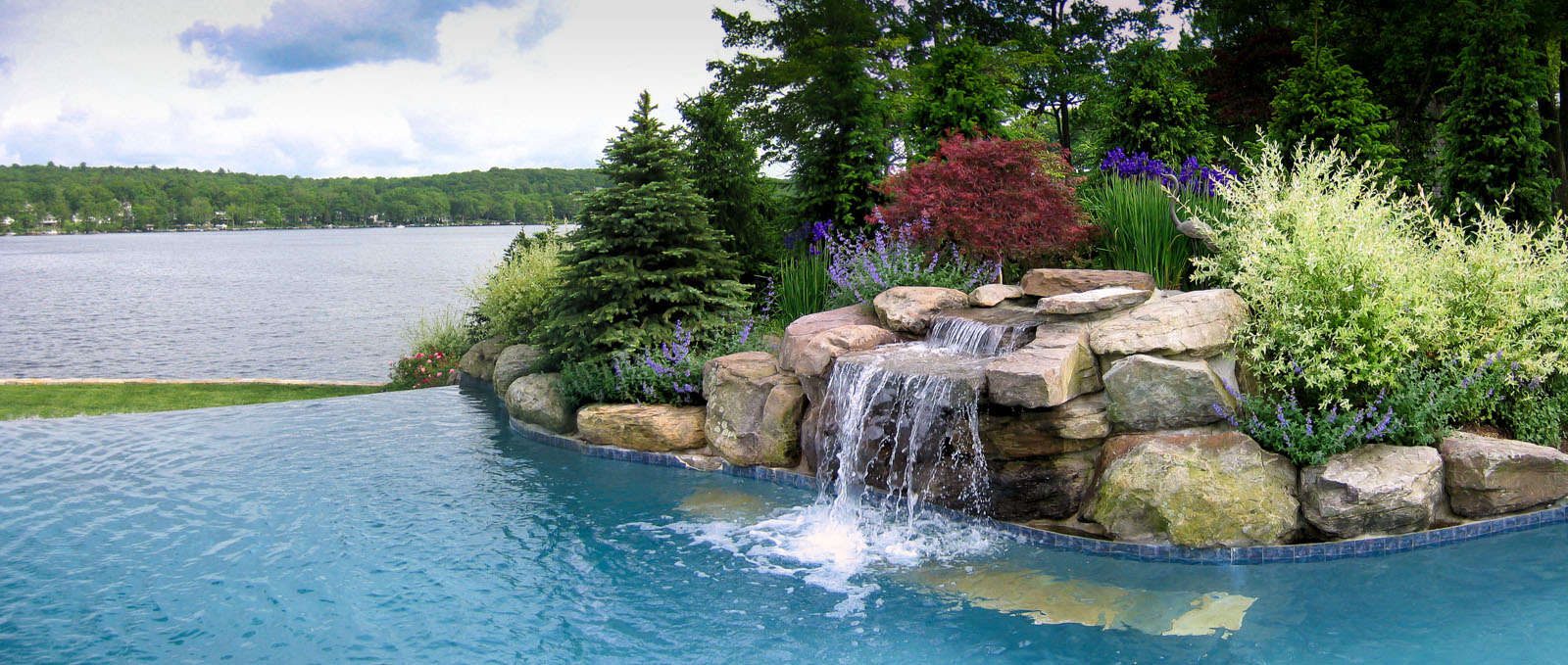 planting design around pool waterfall