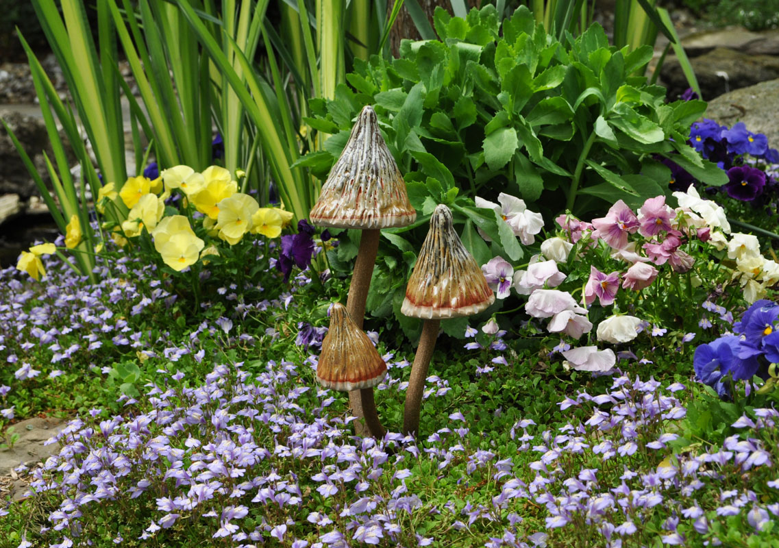 mushroom pottery, garden art, flower bed design