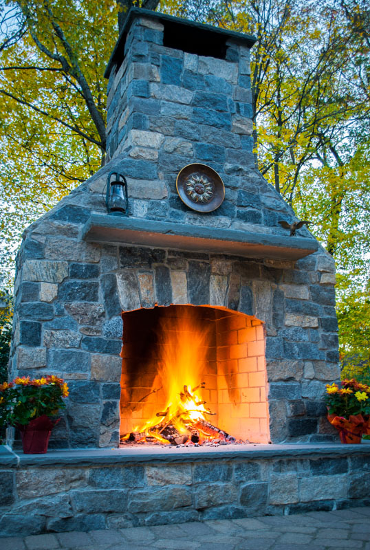 outdoor fireplace, bluestone mantle and heart, granite veneer
