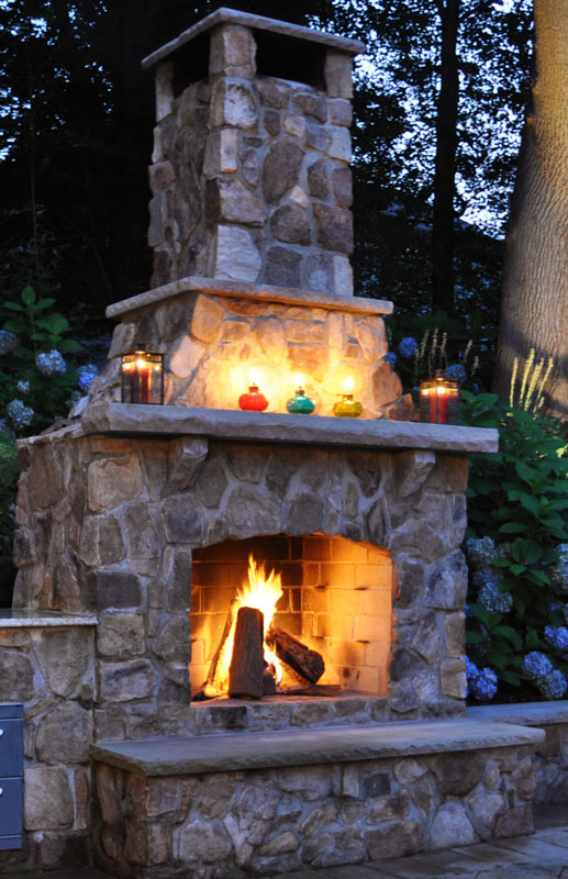fire burning in custom outdoor fireplace