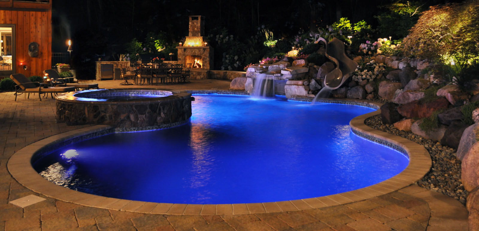 pool, patio, outdoor fireplace, pool waterfall