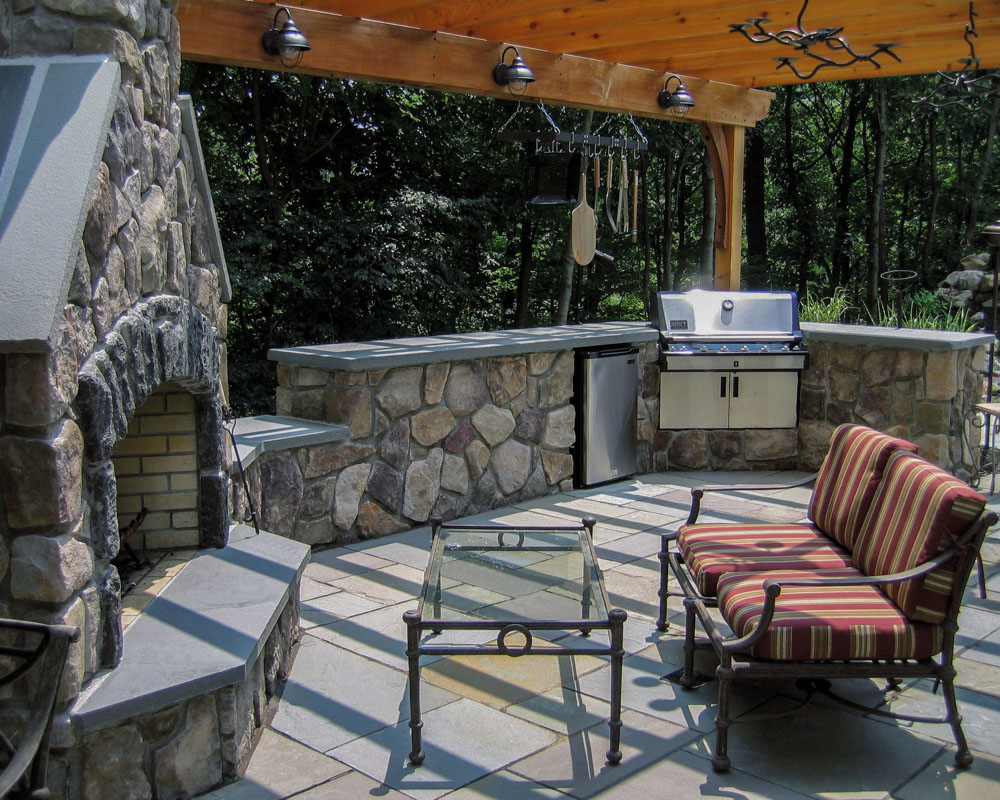 outdoor fireplace under a shade structure