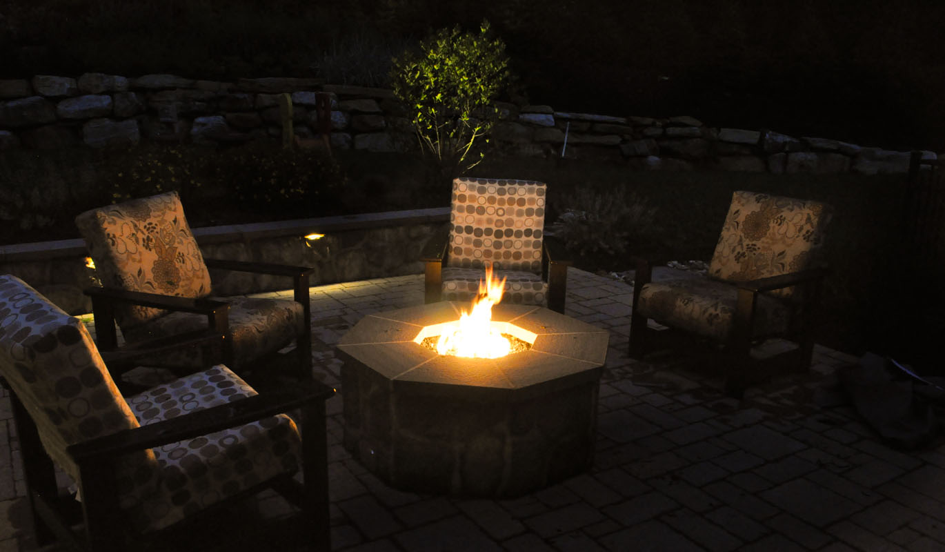 gas fire pit with fire burning, bluestone cap