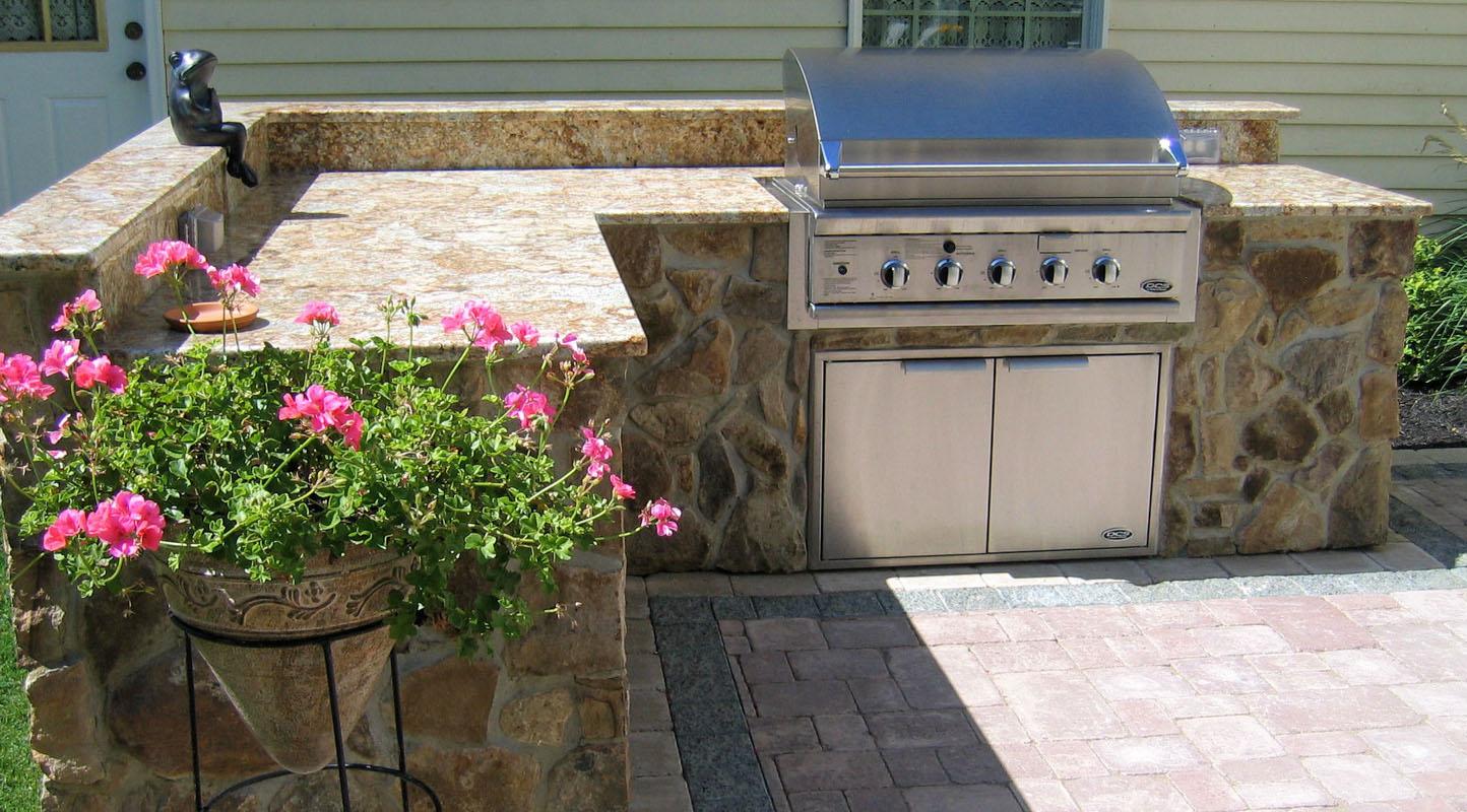 built in outdoor bbq with granite countertop