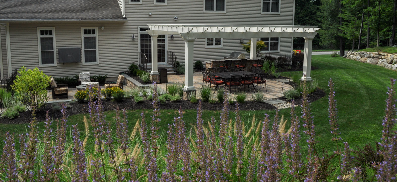 before and after landscaping photo, after photo, patio with pergola and fire pit - north jersey