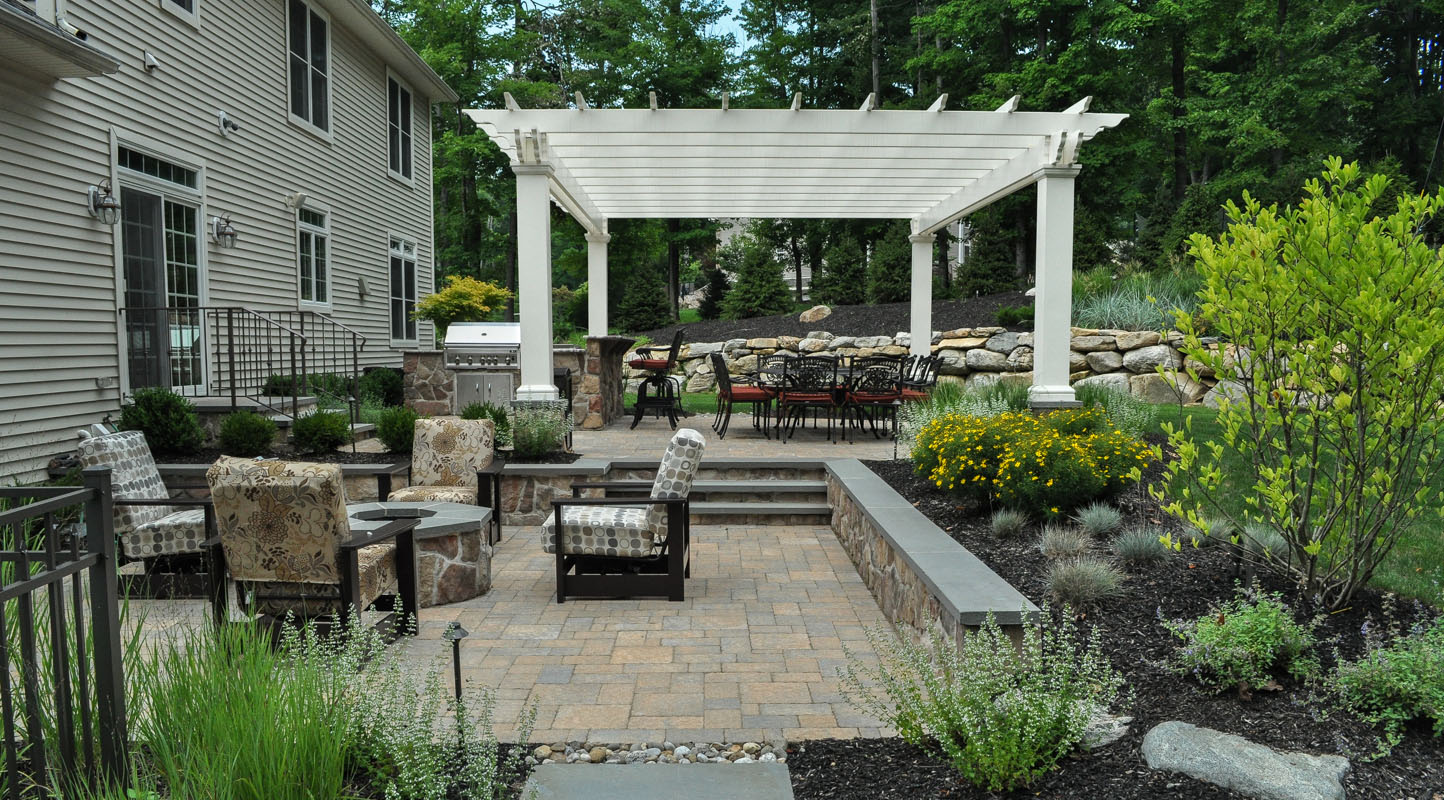 paver patio with built-in fire pit, pergola, and outdoor kitchen - sparta, nj