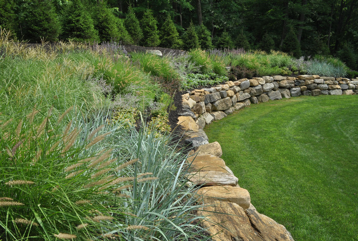 retaining wall with deer resistant plants and grasses - north jersey