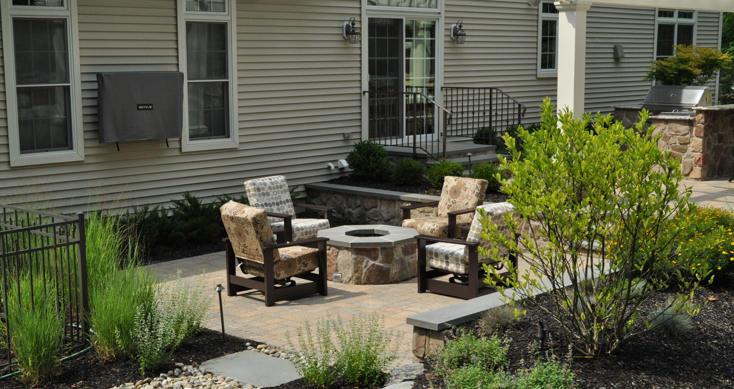 outdoor television mounted on house, gas fire pit with bluestone cap on patio - north jersey