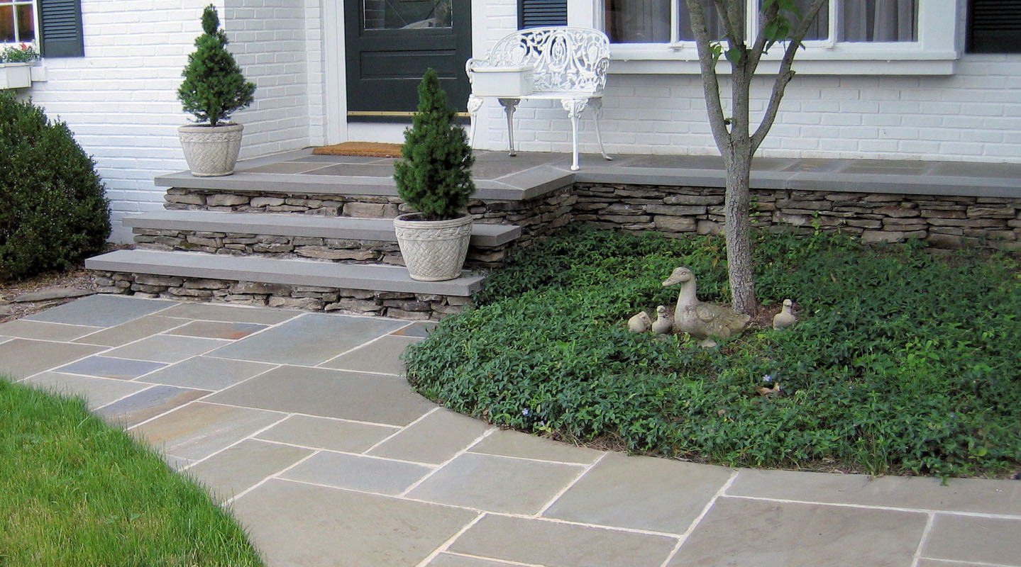bluestone front walk leads to stone slab steps and front porch