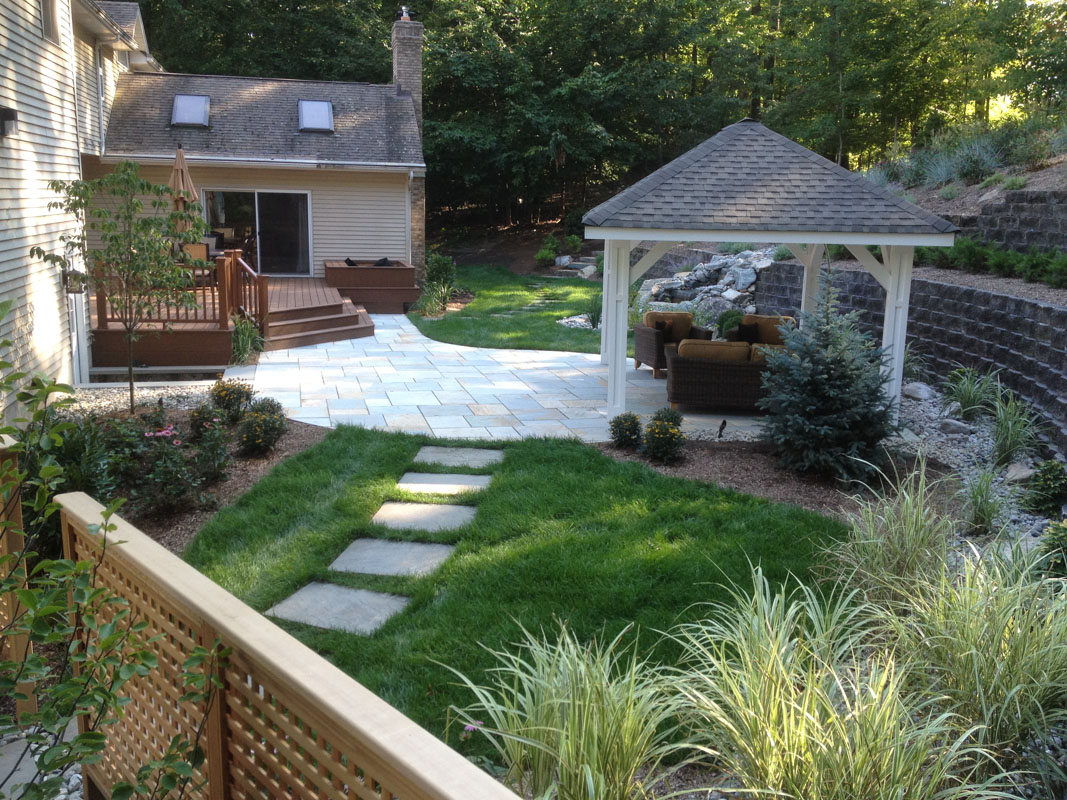 Stepping Stones Lead to Bluestone Patio with Pavilion