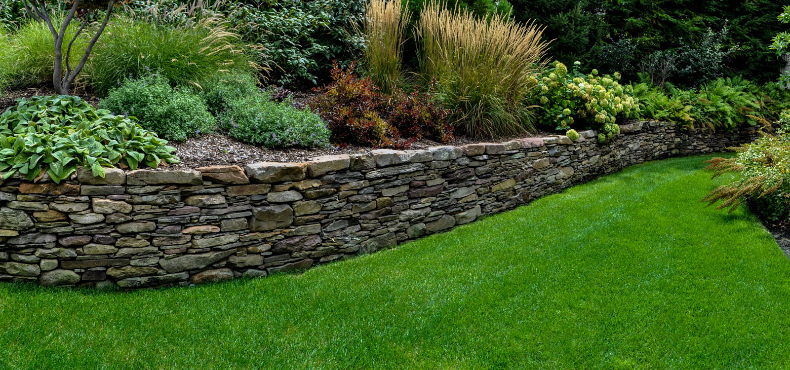 pennsylvania fieldstone retaining wall in nj landscape design