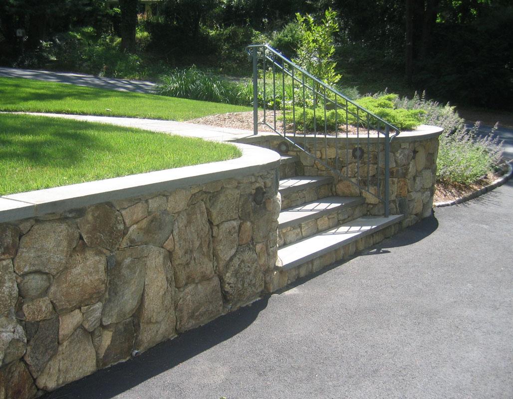 fieldstone retaining wall along driveway