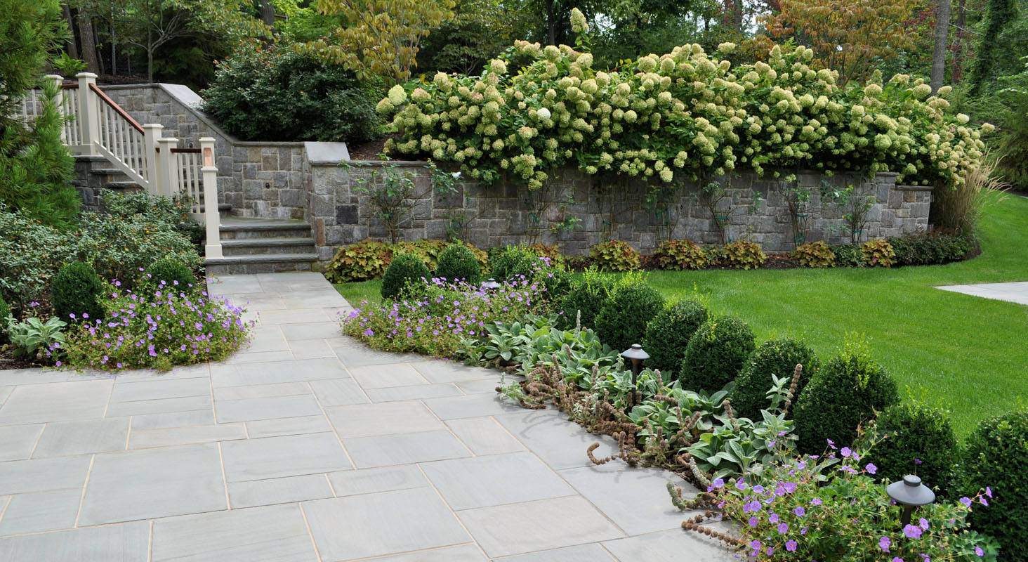 retaining wall with granite veneer, formal nj landscape design