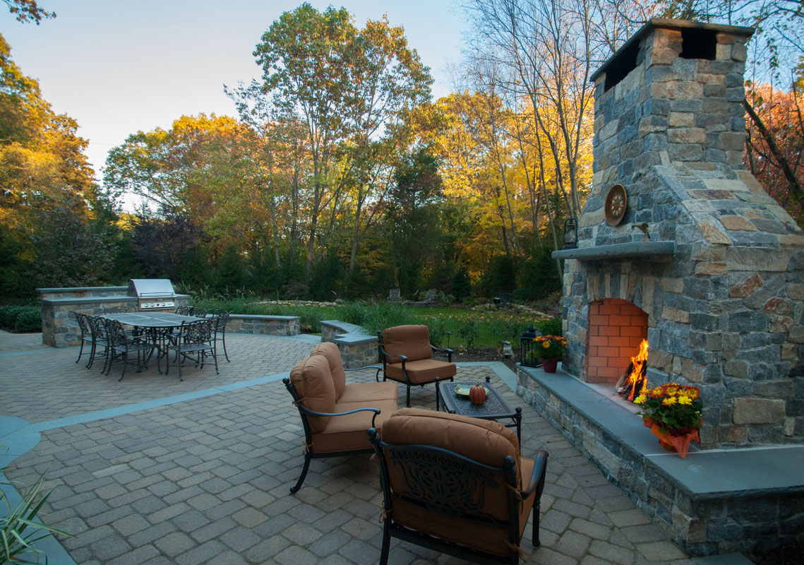 outdoor fireplace and wall with granite veneer