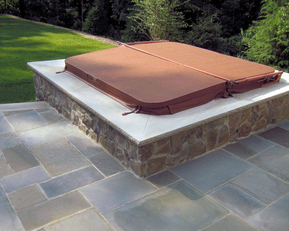 bluestone patio, hot tub with veneer stone