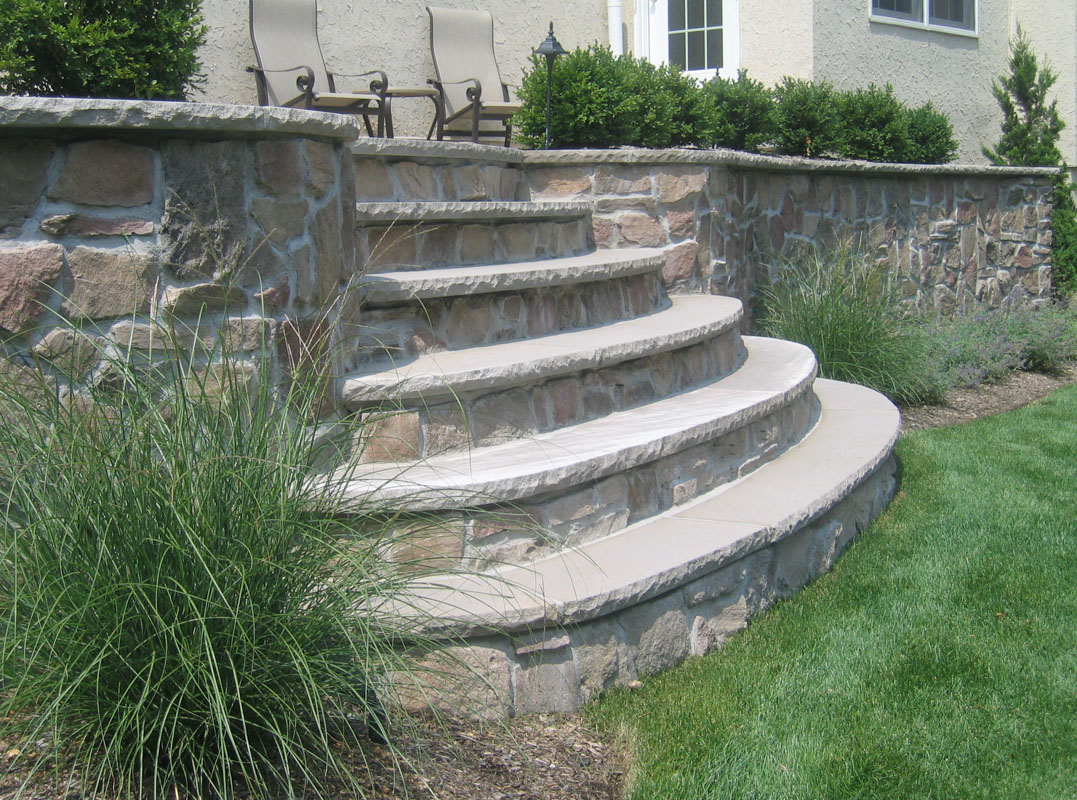retaining wall and slab steps with veneer stone