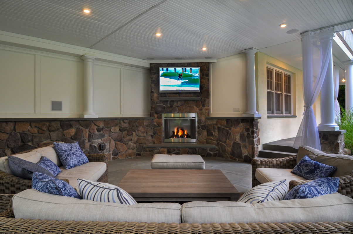 outdoor living room with veneer stone, gas fireplace