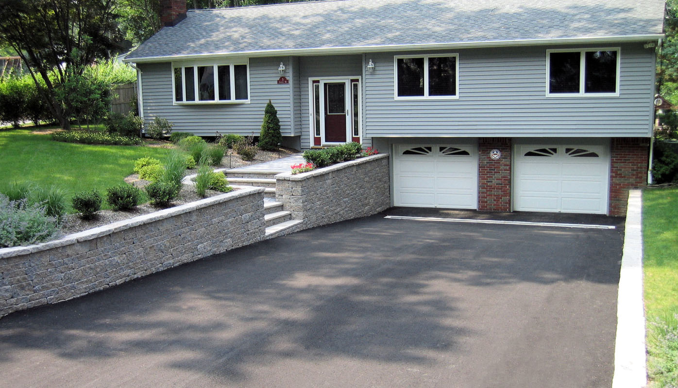 interlocking block retaining wall along nj driveway