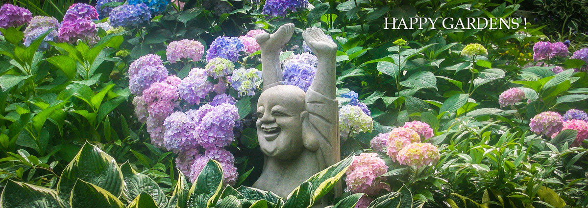 sculpture in garden of hydrangeas