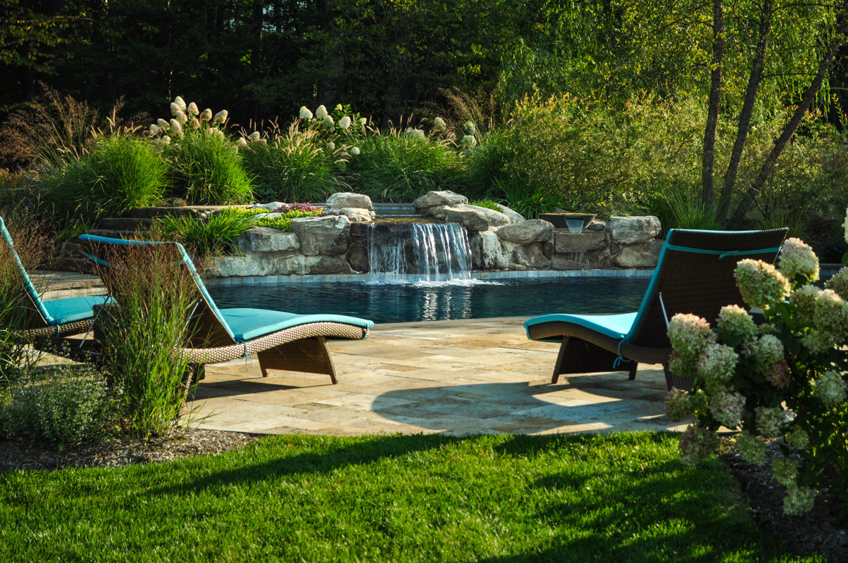 custom swimming pool with natural stone waterfall