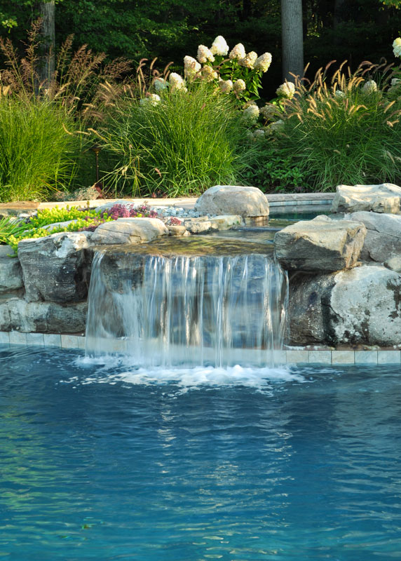 pool waterfall coming from upper level spa