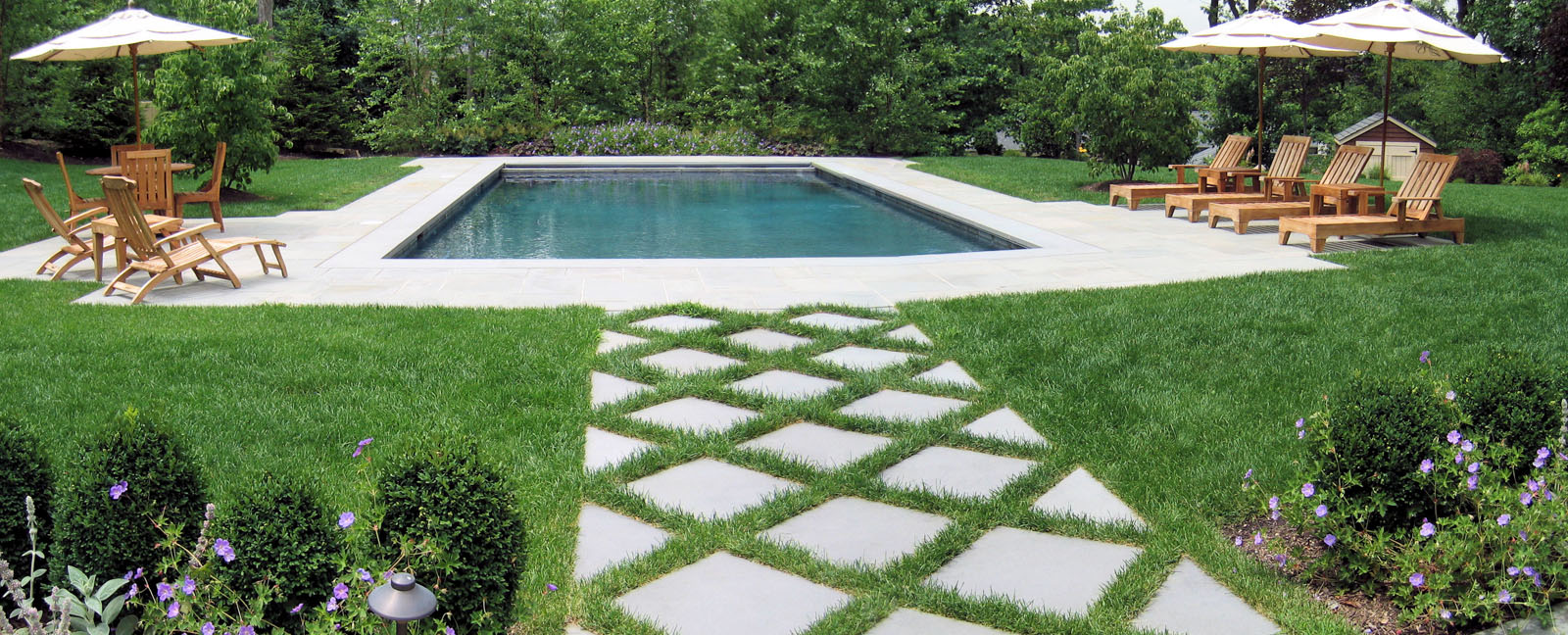 rectangular new jersey swimming pool with two seating areas