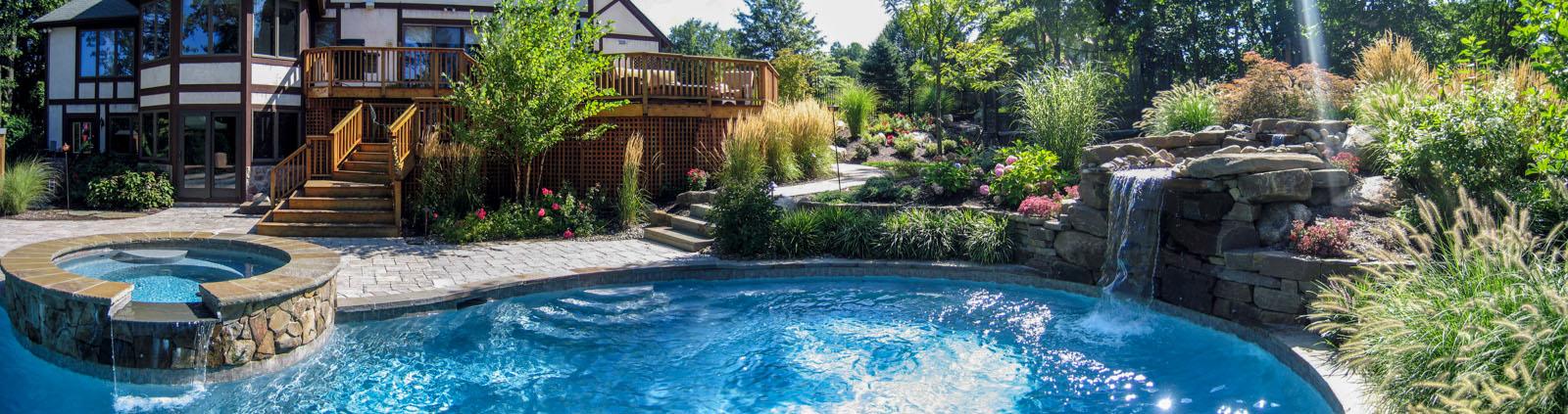swimming pool with bluestone coping, spa, pool waterfall