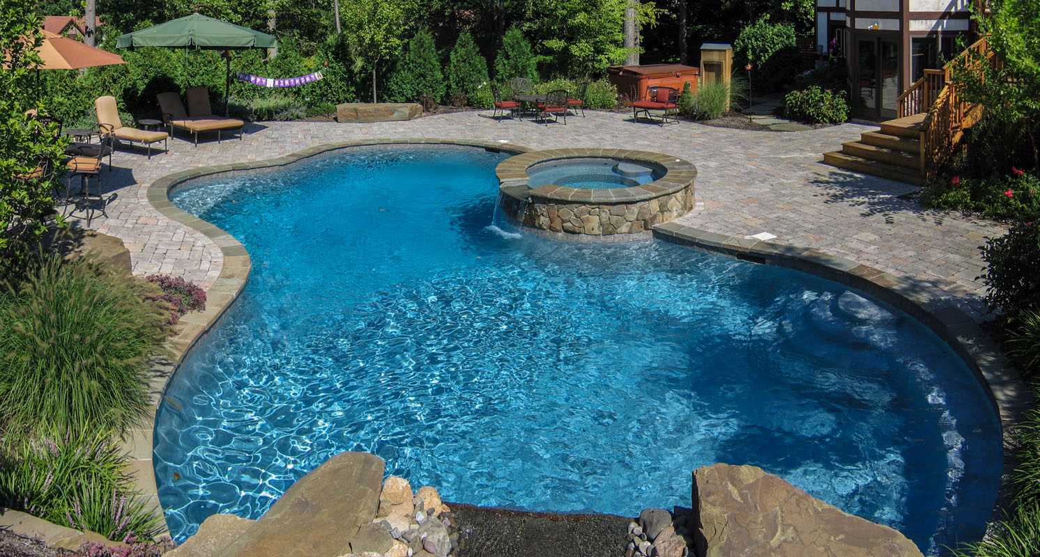custom designed swimming pool with round spa