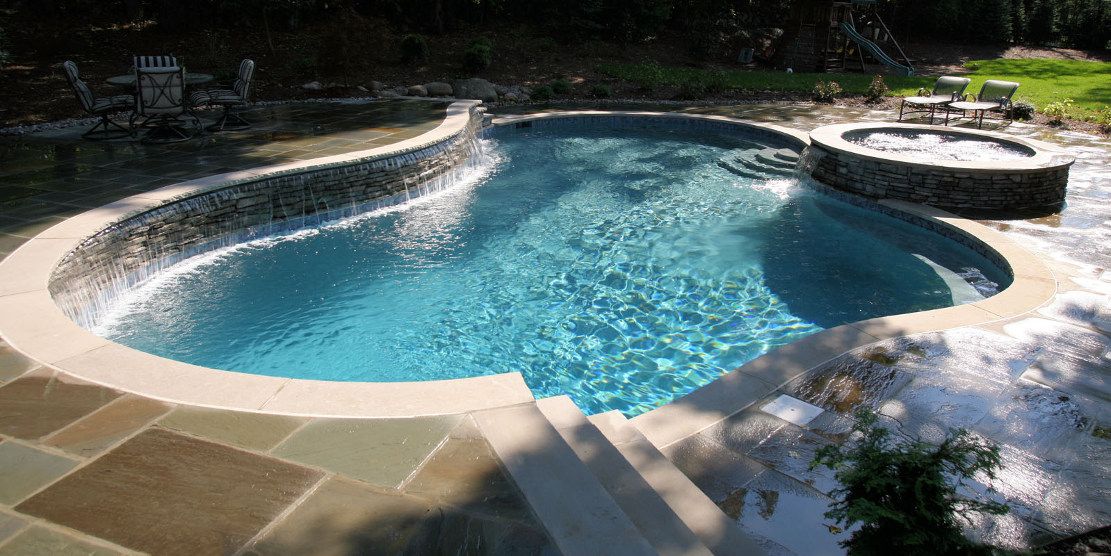 custom gunite swimming pool with spa and waterfall