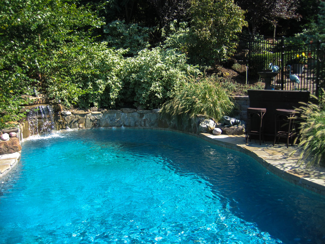 custom swimming pool with pool waterfall