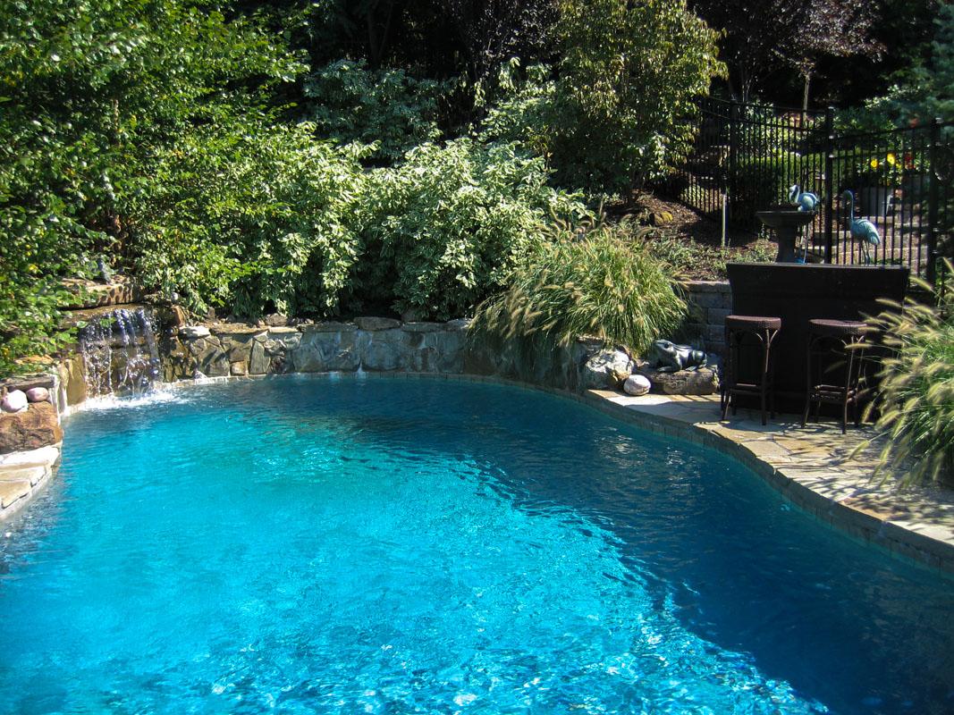 custom swimming pool with pool waterfall