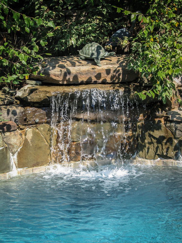 pool waterfall spilling into nj swimming pool