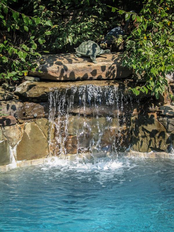 pool waterfall spilling into nj swimming pool